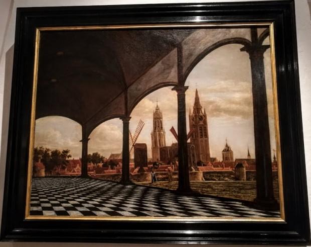 Gezicht op Delft met een fantasieloggia prinsenhof
